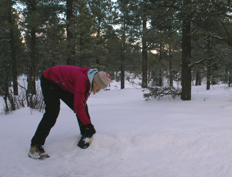 Suzanne digging out snow for a tent site at Grand Canyon's Mather Campground.