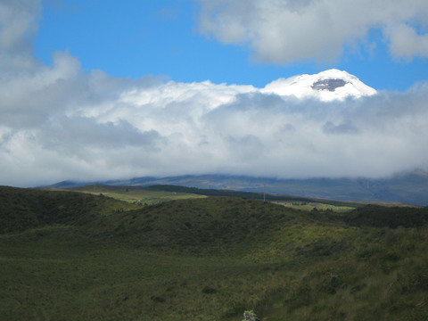 Cotopaxi peeking above the clouds.