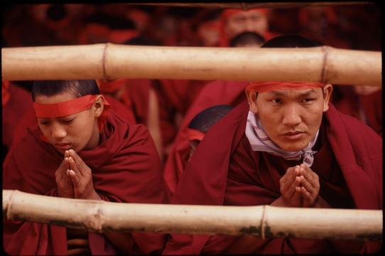 Monks participating in the Kalachakra, a Tibetan ceremony led by the Dalai Lama that is both a world-blessing and an initiation for monks.