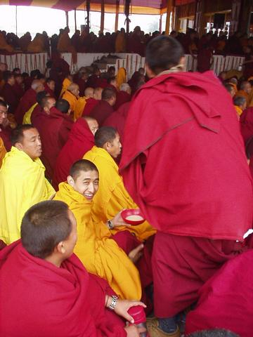 Happy monk, with tea, at the 2003 Kalachakra Initiation, Bodhgaya.
