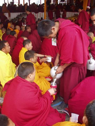 More tea-pouring of monks, 2003 Kalachakra Initiation, Bodhgaya.
