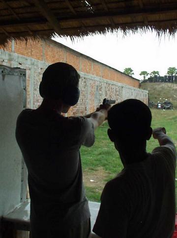 Firing a Colt .45, Phenom Penh.