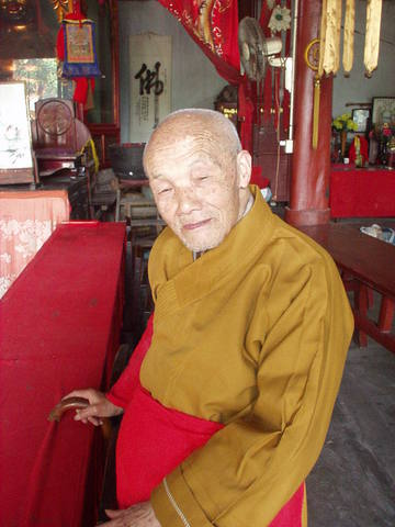 Old monk at a temple in Chengu.