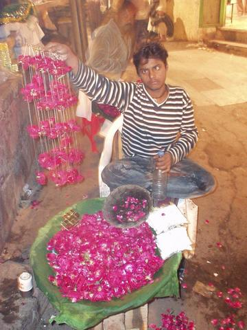 Boy selling rose petals for those asking for Nizam-ud-din's favor.