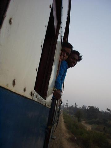 Indians looking out the window of the toy train to Dharamsala.