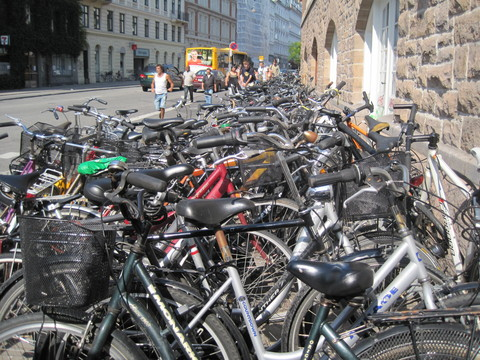 Bicycles outside a train station in Copenhagen, Denmark.