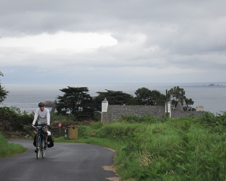 Riding up a lonely stretch of road on the Breton coast.