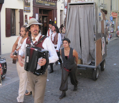 Performers promoting their play at the Festival d'Avignon.