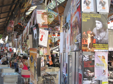 A café in Avignon, covered with posters for the Festival d'Avignon and the larger