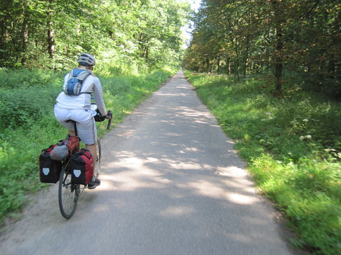 A long, straight bike path leading north from Karlsruhe, Germany.