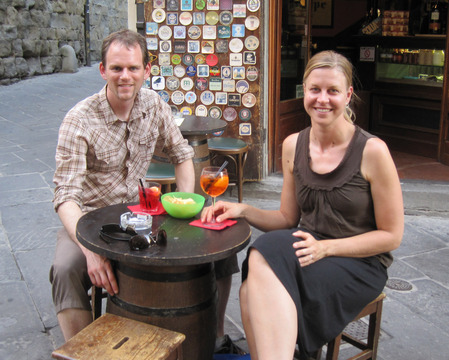 Joe and Suzanne drinking Aperol spritzes in Arezzo, Italy.  Living the cafe lifestyle is a good way to recover after a long day of biking.