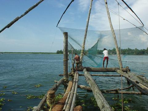 Men working on the cantilevered Chinese fishing nets, Fort Cochin, Kerala.