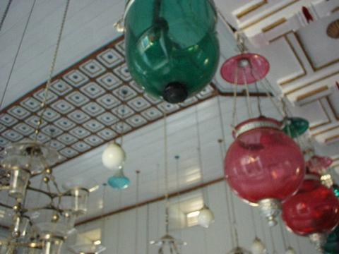 Colored lights hanging from the ceiling of the Mattancherry Synagogue, Kerala.