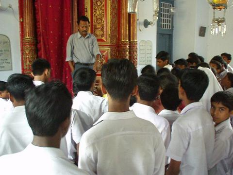 Indian schoolchildren being lectured on Judaism.