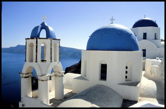 One of the many blue domed churches of Santorini.