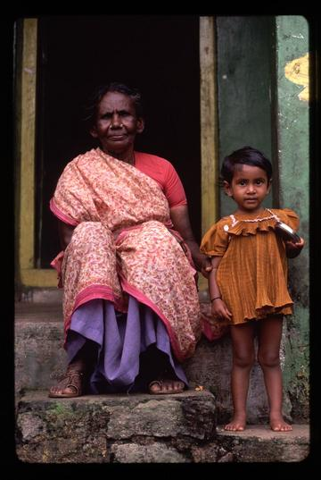 An old woman and child sitting on their doorstep in a small village near Hampi, Karnataka state.