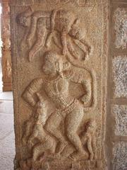 The god Hanuman, whipping his enemies about with his tail.