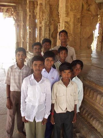 A group of boys who became entranced by my digital camera.