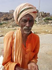 Hindu holy man, or Sadhu, asking for money on the path between Hampi bazaar and the Vittala Temple.