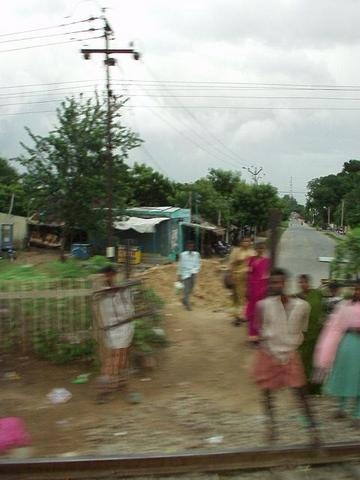 Passing a village on the train.