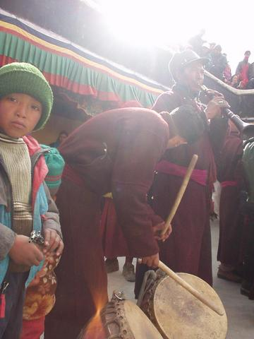 Men playing drums and tibetan horn at the 2003 Spituk Festival.
