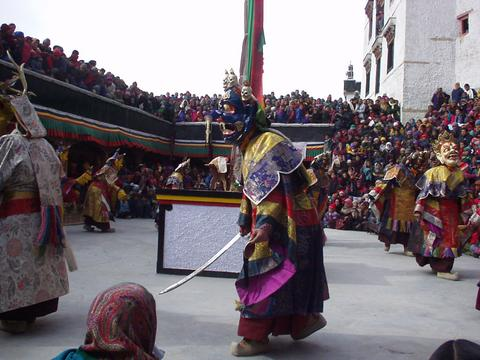 Dancing masked monks at the Spituk Festival, 2003.