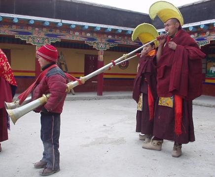 Ladakhi monks playing large horns at the 2003 Spituk Festival.