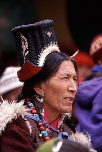 Ladakhi woman watching the spectacle at the Spituk Winter Festival.