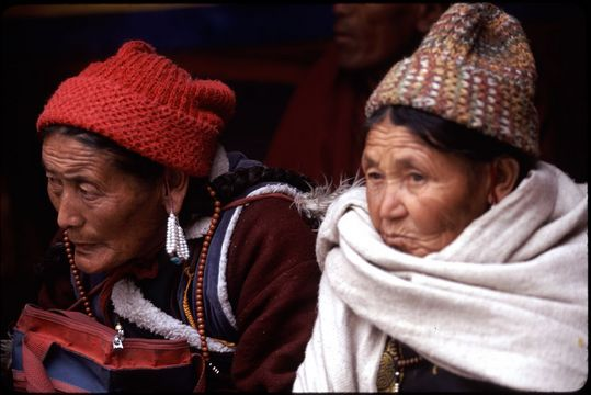 Women watching the winter festival at the Spituk Gompa, just outside of Leh in Ladakh, northern India.