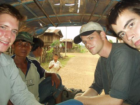 Will, two Laos, yours truly, and Alex in the back of a tuk-tuk.