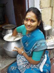 Woman making idli dough, Madurai.