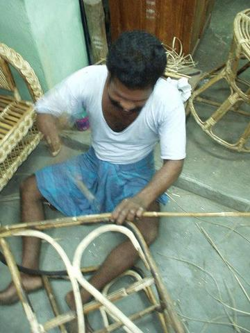 Man making wicker chairs, Madurai.