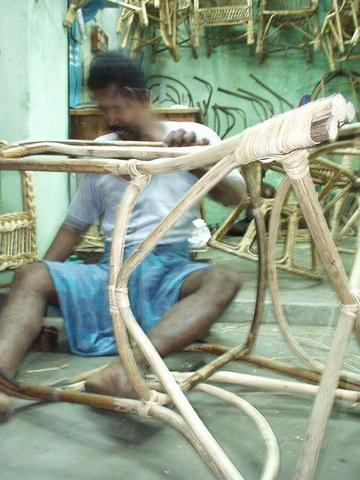 Man bending wicker to make a chair, Madurai.