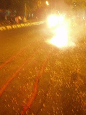 Crackers going off in a long chain near Marine lines.
