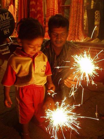 Boy with sparklers for Diwali.
