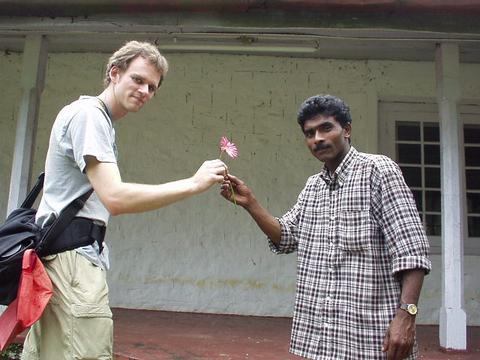 Rajan, the Assistant Manager's cook, hands me a flower.