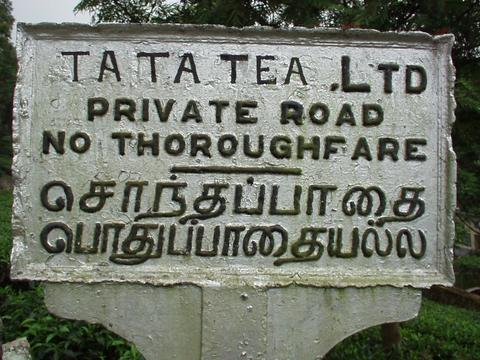 Sign for a road owned by the stuttering Tata Tea Corporation.