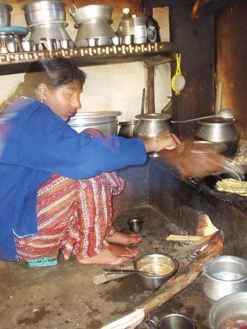 Priya, a Toda woman, preparing dinner in her village in the Nilgiri hills near Kothagiri.