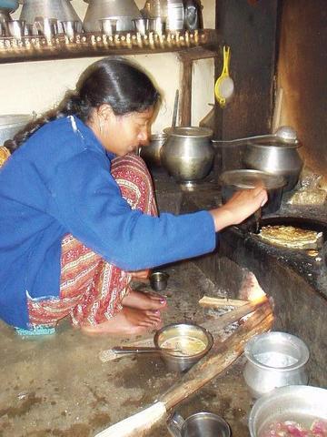 Toda woman preparing dinner in the Nilgiri Hills, near Kothagiri.