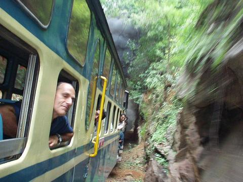 Herve, the French doctor, looking out of the window of the Ooty train.