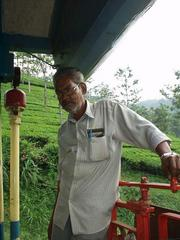 The brakeman on the last car of the Ooty train, on the way down.
