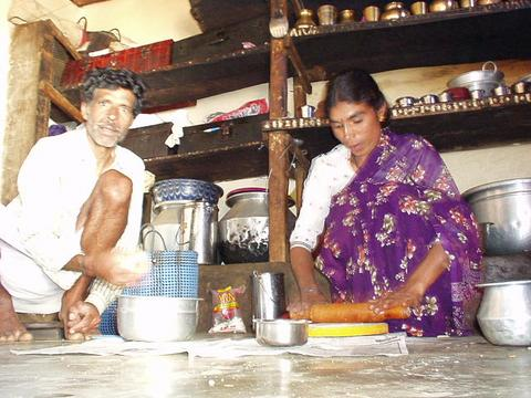 Toda village elder, named Onir Katan, preparing dinner for us with another Toda woman.