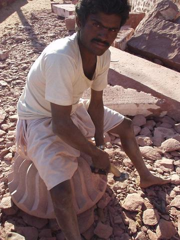 Man carving rock for an addition to a Jain temple, Osiyan, Rajasthan.