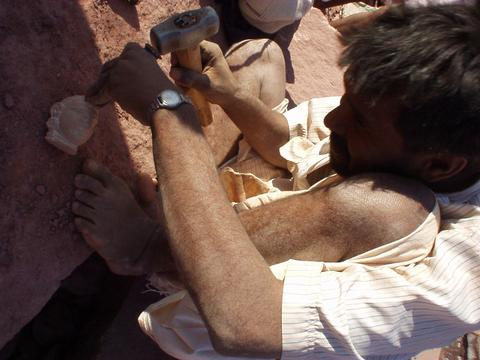 Man carving the head of a figure for a Jain temple in Osiyan, Rajasthan.