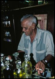 Suleyman with the Pyrex bottles of essential oils.